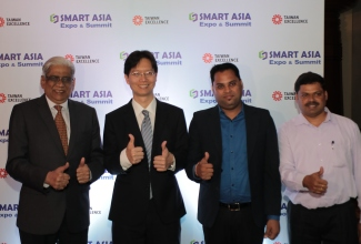 L-R Mr. Balram Menon, President, WTC Mr. Thomas Huang, ED, Exhibition Dept, Taipei Mr. Amith Kumar, Sales Manager QNAP, Mr. Leon Anthony, BD, Aver